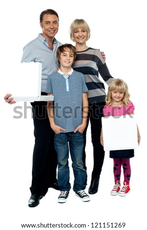 Casual portrait of a family of four. Father and daughter holding pizza boxes.