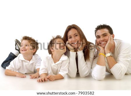 Casual portrait of a healthy, attractive young family taking a break and relaxing