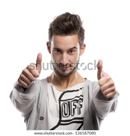 Casual portrait of a young man with thumbs up, over a gray background