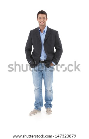 Casual portrait of young businessman, standing with hands in pocket, smiling at camera, isolated on white. #147323879
