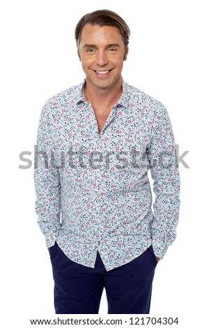 Casual shot of smiling handsome relaxed male model. Isolated over white.