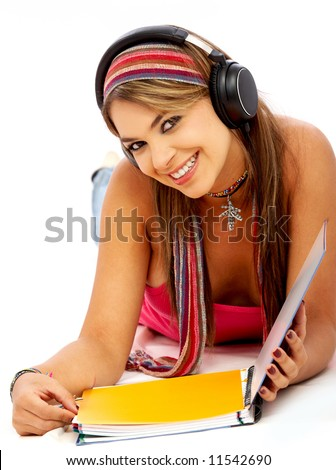 Stock photo casual student listening to music while studying isolated