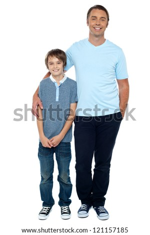 Casual studio shot of father and son. Full length portrait.