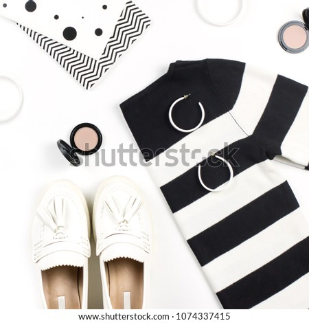 Casual style woman clothes and fashion accessories flat lay. Trendy patterns and prints concept. Top view #1074337415