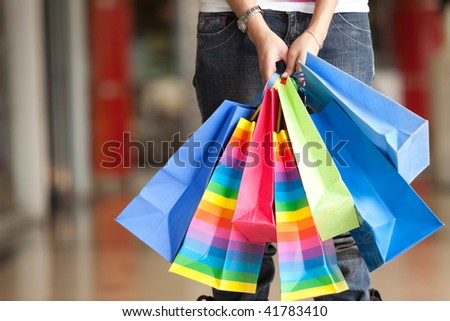 Casual woman carrying shopping bags in a mall