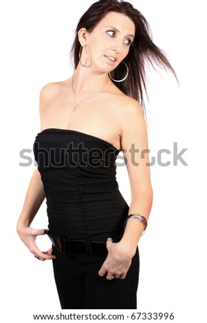 Casual woman dressed in a black bustier top and pants on a white background