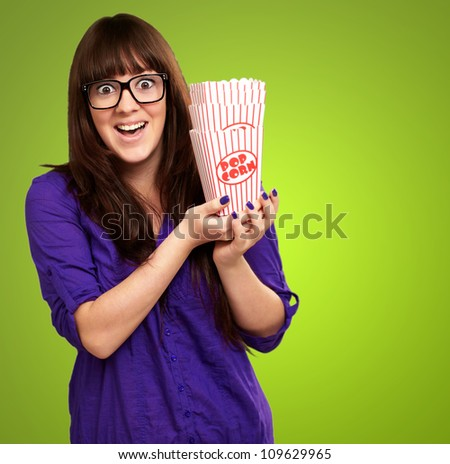Casual Woman Holding Popcorn Container Isolated On Green Background