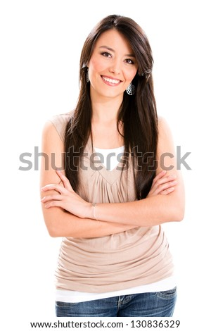 Casual woman smiling with arms crossed - isolated over white