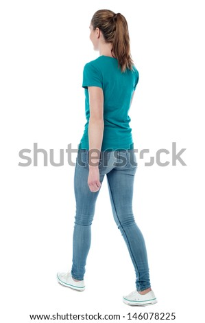 stock photo casual woman walking away from the camera 146078225
