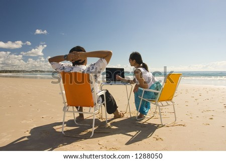 Casual workers having a business meeting at the beach