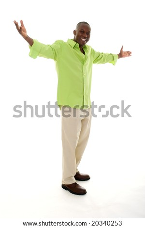 stock photo : Casual young African American man standing in a bright green shirt with a welcoming hands apart gesture.