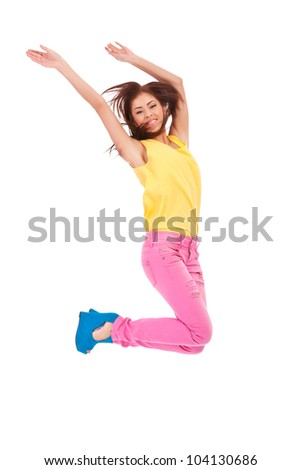 casual young excited woman  jumping in air on white background