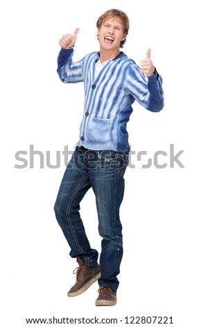 Casual young male model with a thumbs up gesture. Handsome man has a positive expression on his face and smiling. Full length portrait isolated on white background.
