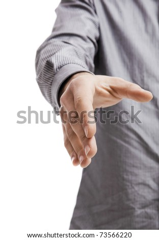 Casual young man giving a handshake, isolated on white