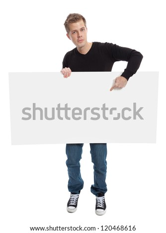 Casual young man holding a blank board