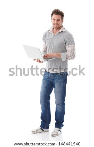 casual young man holding laptop ...