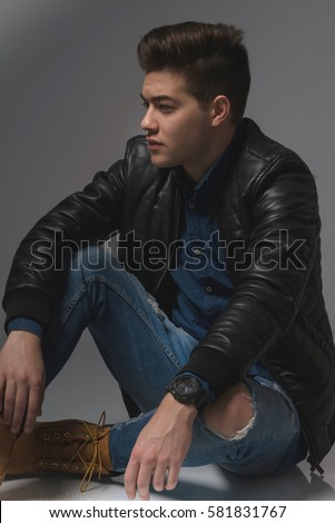 Casual Young Man In Black Leather Jacket And Denim Jeans Low Key