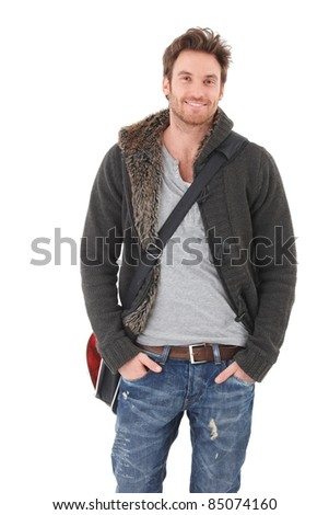 Casual young man in jeans and cardigan smiling over white background.?
