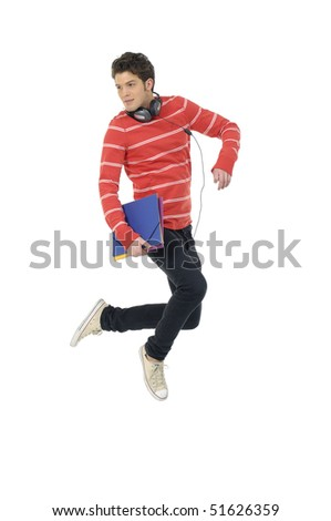 casual young man jumping on white