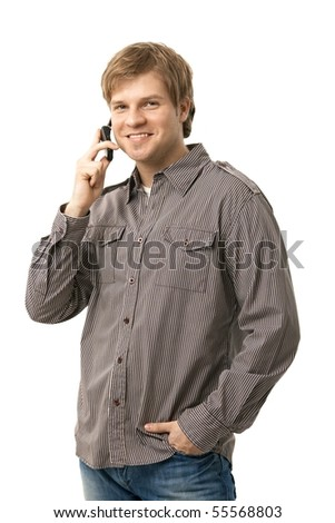 Casual young man talking on mobile phone, smiling. Isolated on white.