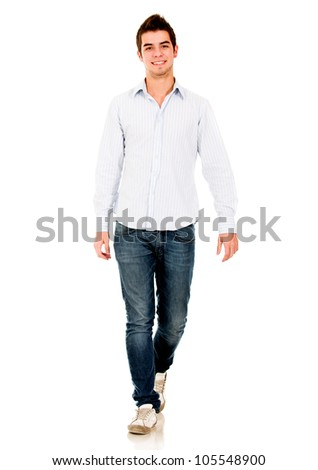 Casual young man walking - isolated over a white background