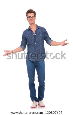 casual young man welcoming you with his arms opened and with a comforting smile. isolated on a white background - stock photo
