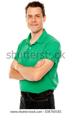 Casual young man with crossed arms isolated over white