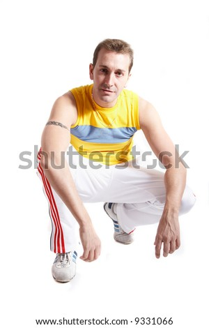Casual young man with sportive clothes isolated on white