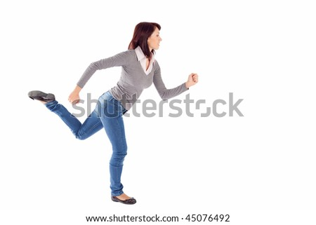 Casual young woman in running pose, isolated on white background.
