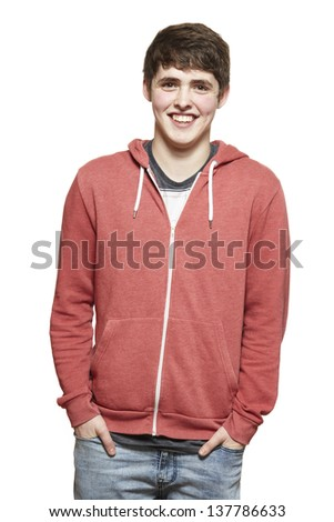 Casually dressed teenage boy smiling on white background