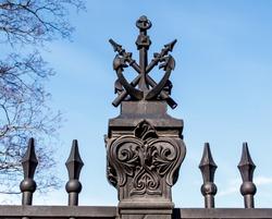 Cat Anchor - decorative element of the lattice of the Summer Garden. Kronshtadt, Saint Petersburg, Russia