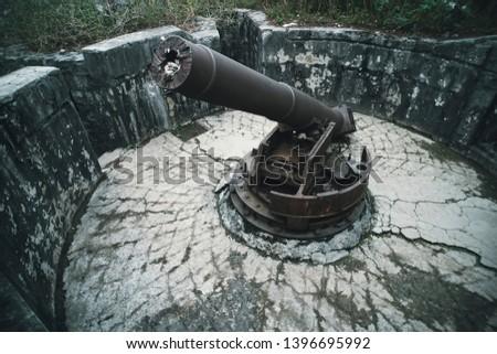 Cat Ba Island, Lan Ha Bay, Vietnam 09.11.2018: Cannon Fort Artillery gun 138 mm Soldiers. The gun posts World War II, French during the Indochina War, Viet Cong Vietnam War. #1396695992