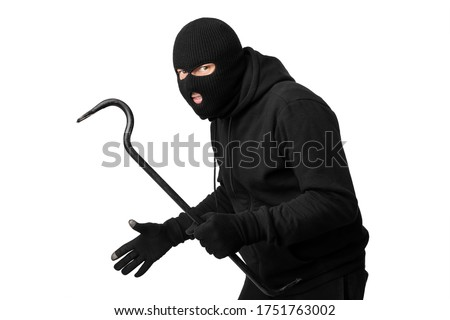 Cat Burglar Concept. Portrait of sneaky masked criminal holding crowbar, copy space, isolated over white studio wall Stockfoto ©