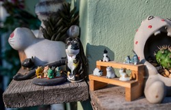 Cat ceramic doll on the wooden table