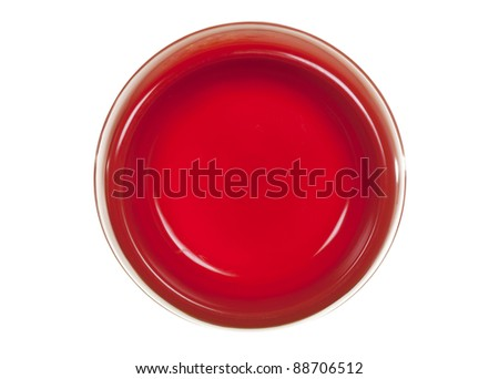 Cat/dog feeding red bowl, view from above; isolated on white background
