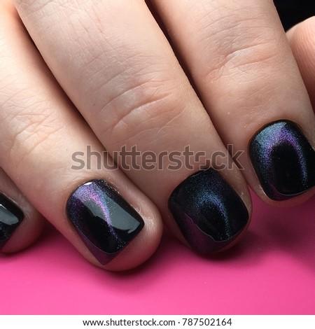Stock Photo Cat eyes nail art manicure salon beauty violet and blue night sky