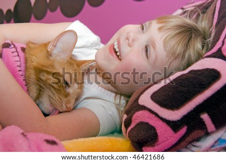 cat licking child