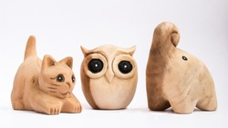 Cat, Owl and Elephant wooden dolls with white background