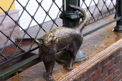 cat sculpture on the porch in Yaroslavl