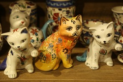 Cat statue, trinket as a decoration object on flat background