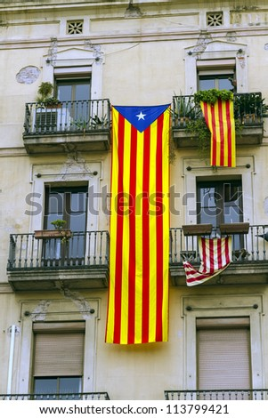 Catalan flags placed on balconies, Something done the day of National Day of Catalonia