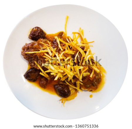 Catalan stew with raisins and plums. Isolated over white background #1360751336