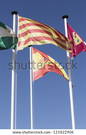 Catalonia and Spain flag waving in the wind
