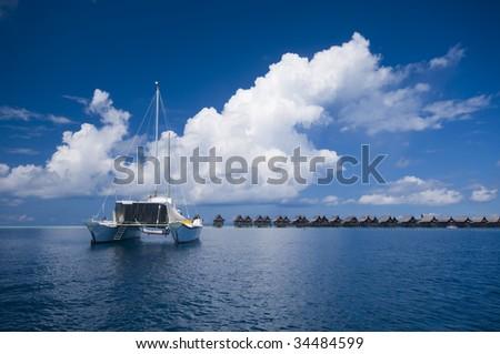 Catamaran docks by tropical island resort