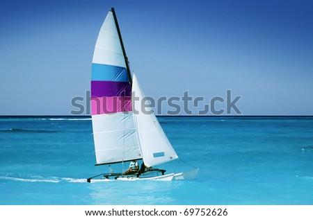 Catamaran in caribbean sea on blue sky background