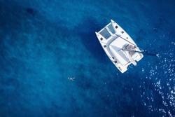 Catamaran in open sea - aerial / drone view