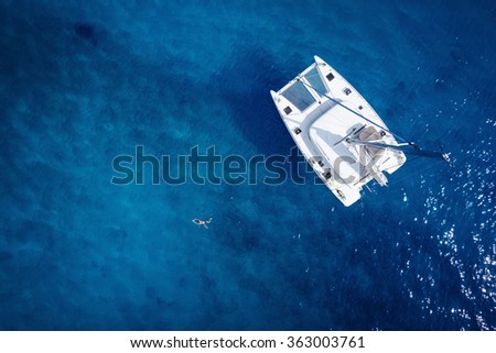Catamaran in open sea - aerial / drone view #363003761