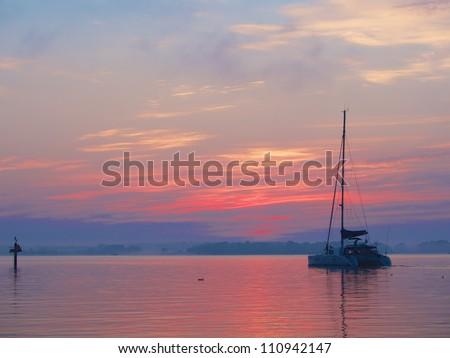 Catamaran leaving the harbor of St. Michaels, Maryland at dawn
