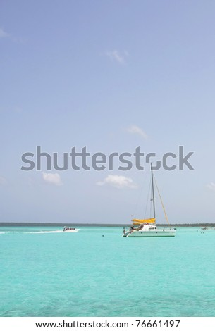 catamarana and people swiming in caribbean sea - stock photo