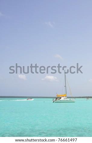 catamarana and people swiming in caribbean sea